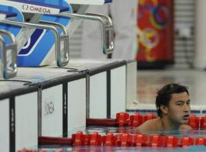 Guam's Christopher Duenas after he finished last in his heat of the men's 100-meter freestyle preliminaries Tuesday at the National Aquatics Center at the Beijing Olympic games. (Gannett News Service)