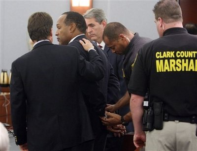O.J. Simpson is handcuffed after a verdict of guilty on all counts
