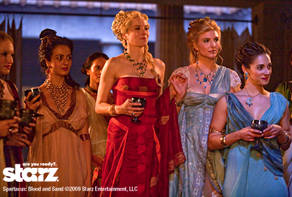 Lucy Lawless (center) as Lucretia