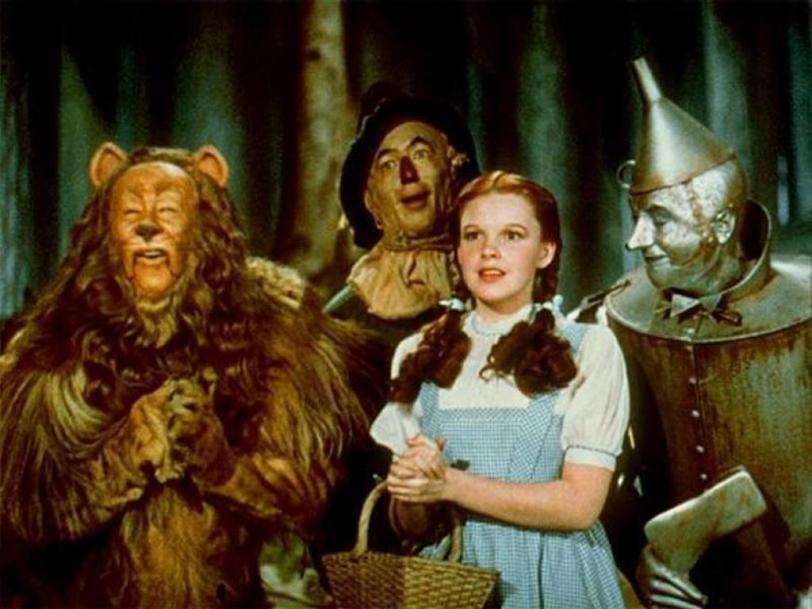 The Cowradly Lion, The Scarecrow, Dorothy, and the Tin Man of the Wizard of Oz