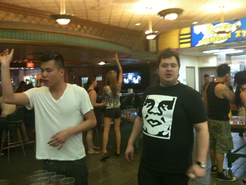 Alex and Oleg playing Beer Pong