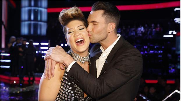 "Maroon 5 frontman Adam Levine, right, kisses Tessanne Chin on the cheek after Chin was announced the season five winner of ""The Voice"" on Dec. 17, 2013, in Los Angeles. C  AP"