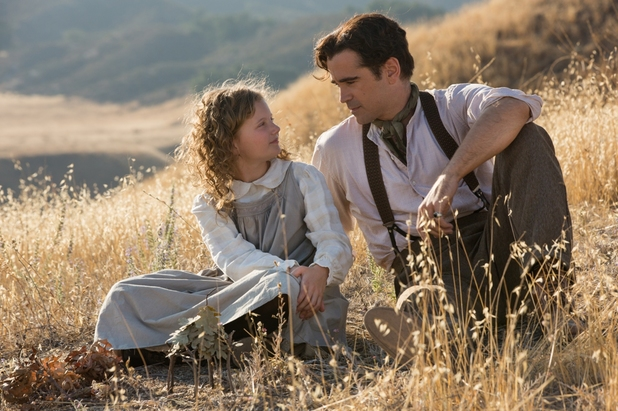 Annie Rose Buckley as the young P.L. Travers and Colin Farrell as her father in Saving Mr. Banks