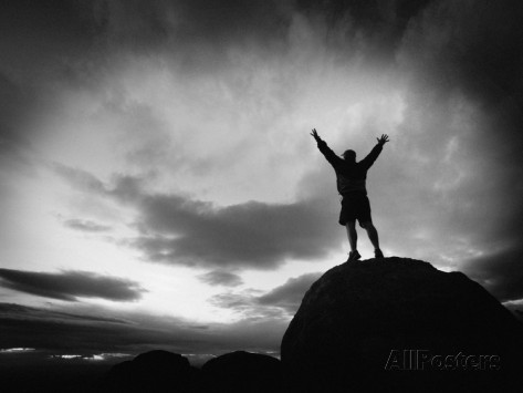 kevin-lange-silhouette-man-arms-raised-into-the-new-mexico-sky-in-black-and-white